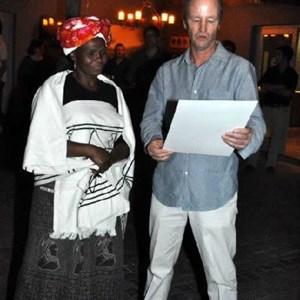 Simon handing over the merit award to Mavis