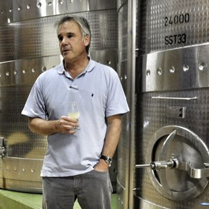 Jeff tasting a blending component from tank