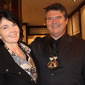 Eric van Heerden and his wife from Triggerfish - winning the Trophy for their Floating Dutchman RUM