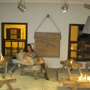 The cavewoman modelling with the flaming furniture